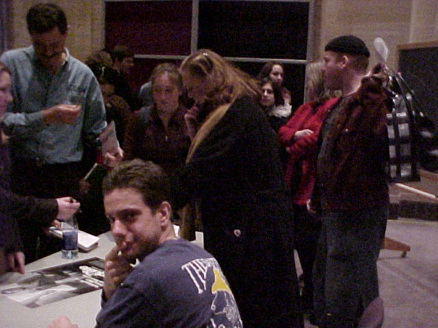 This is a two-shot of Pete and Kathleen Turner as she signs autographs.